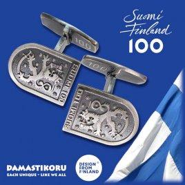 Damastikoru Suomi100 Leijona Kalvosinnapit